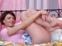 Cute Babe Angela Teases Her Little Pink Pussy With A Toy