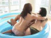 Three playful babes get fucked in a plastic pool