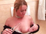 Mature woman gagging in a toilet
