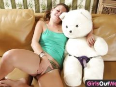 Woman Holding Bear Starts To Finger Her Pussy