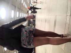 Long legged woman in a short skirt gets followed by a spy c