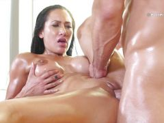 Long haired brunette Amia Miley oiled up for lusty pounding sesion