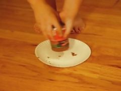 Woman Puts Her Feet In A Plate Of Dogfood