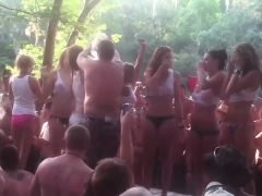 Big beach party where they\'re having a fun wet T-shirt cont