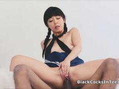 Japanese coed rides big black cock in uniform