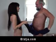 Oldman wanking while watching porn gets young pussy rub