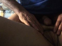 He rubs her muff while stroking his dick