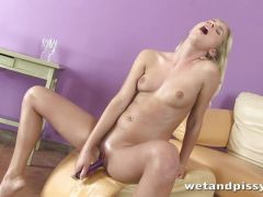 Blonde Noleta gives herself an orgasm after piss play