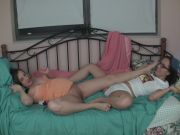 Two Girls Give A Hot Footjob.