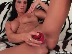 Mommy fucks herself with a dildo