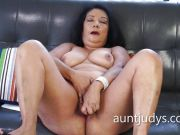 Mature Isis fucks her chunky monkey with a toy