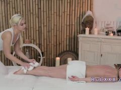 Blonde gives massage with feet