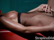 Strapon play in fishnets