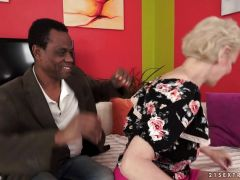 Mature blonde fucked by a black cock