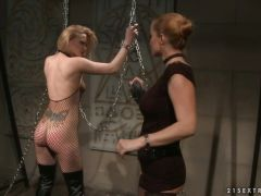 Katy Borman sucks a sex toy while being tied