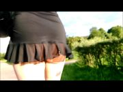 Flashing in little transparent black dress on the road.