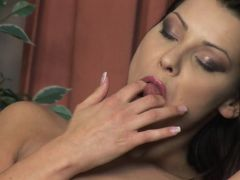 Sexy brunette strips and fucks herself with her favourite toy