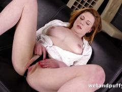 Redhead plays with her pussy