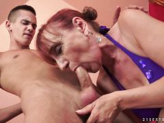Mature redhead riding cock