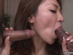 Asian floozy gets two cocks to fool around with
