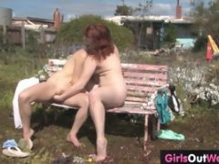 Horny Ladies Get Naked In A Field And Suck Pussy