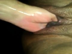 Ramming her horny wet muff with his fist